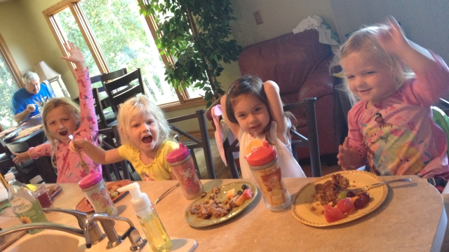 Little ladies eating breakfast